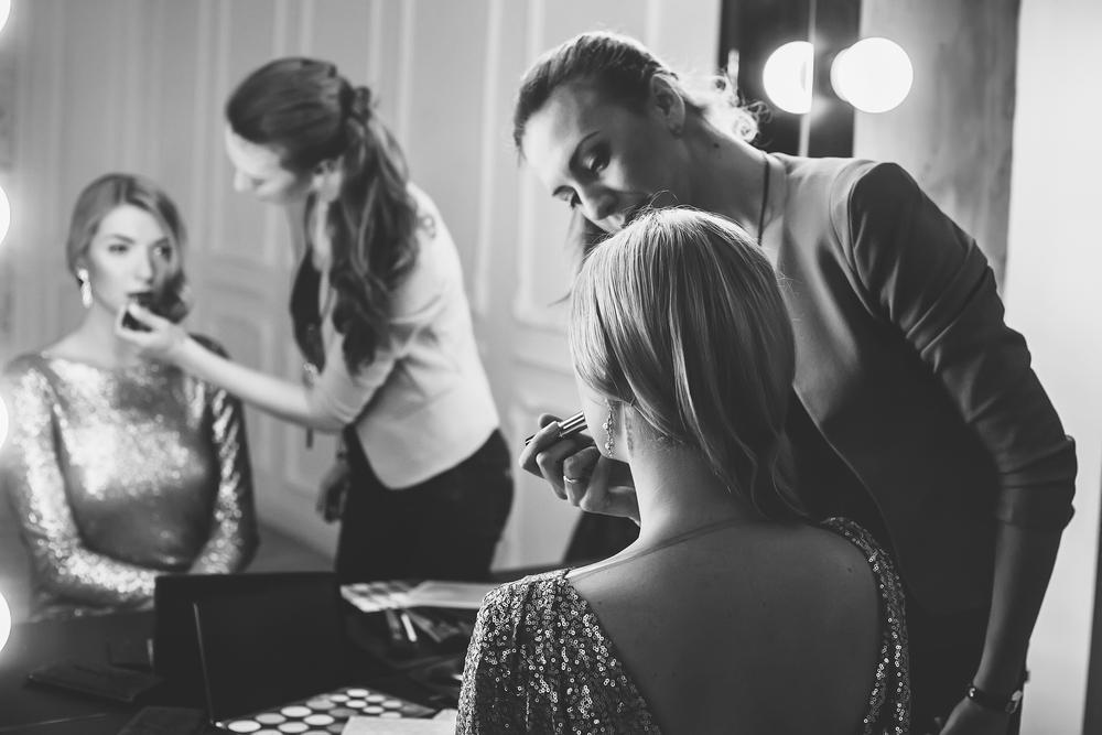 Backstage makeup artist.